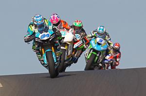 Wizard at work: Alastair Seeley leads a snake of bikes in the Supersport race, his 22nd win at the NW200