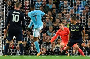 Manchester City's English midfielder Raheem Sterling (2L) scores his team's first goal during the English Premier League football match between Manchester City and Everton at the Etihad Stadium in Manchester, north west England, on August 21, 2017. / AFP PHOTO / Oli SCARFF / RESTRICTED TO EDITORIAL USE. No use with unauthorized audio, video, data, fixture lists, club/league logos or 'live' services. Online in-match use limited to 75 images, no video emulation. No use in betting, games or single club/league/player publications.  / OLI SCARFF/AFP/Getty Images