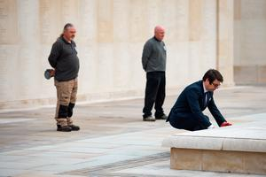 Staff at the deserted National Memorial Arboretum in Alrewas, Staffordshire, observe a two minutes' silence to commemorate the 75th anniversary of VE Day. Mark Ellis, head of visitor experience, laid a wreath. Normally the Arboretum would welcome around 10,000 visitors to mark such an occasion. PA Photo. Picture date: Friday May 8, 2020. See PA story MEMORIAL VE. Photo credit should read: Jacob King/PA Wire