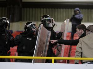 ©Press Eye Ltd Northern Ireland - 10th March 2013 Mandatory Credit - Picture by Darren Kidd /Presseye.com   Setanta Sports Cup, quarter final, second leg, Linfiled v Shamrock Rovers. PSNI offices try to restore calm after Shamrock Rovers fans broke through a cordon to taunt Linfield fans
