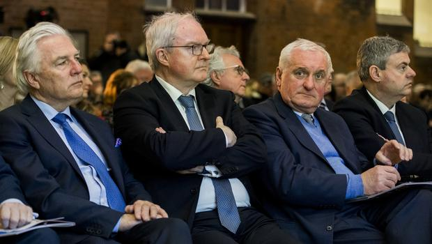 L-R Dr. Len O'Hagan, Sir Declan Morgan, former Taoiseach Bertie Ahern, and Martin Frazer, listen to EU Brexit negotiator Michel Barnier during a lecture at Queen's University Belfast, reflecting on the process. PA Photo. Picture date: Monday January 27, 2020. See PA story POLITICS Brexit Ulster. Photo credit should read: Liam McBurney/PA Wire