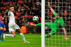 CSKA Moscow's Russian goalkeeper Igor Akinfeev accidently kicks the ball into his own net after saving from Tottenham Hotspur's English midfielder Dele Alli (L) during the UEFA Champions League group E football match between Tottenham Hotspur and CSKA Moscow at Wembley Stadium in north London on December 7, 2016. / AFP PHOTO / Ben STANSALLBEN STANSALL/AFP/Getty Images