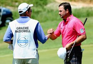 KAVARNA, BULGARIA - MAY 19:  Graeme McDowell of Northern Ireland shakes hands with his caddie Ken Comboy after his victory in the semi-final of the Volvo World Match Play Championship at Thracian Cliffs Golf & Beach Resort on May 19, 2013 in Kavarna, Bulgaria.  (Photo by Andrew Redington/Getty Images)
