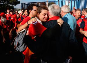 PARIS, FRANCE - OCTOBER 16: Munster fans console each other after hearing of the news of the death of Munster coach Anthony Foley prior to the European Rugby Champions Cup match between Racing 92 and Munster at Stade Yves-Du-Manoir on October 16, 2016 in Paris, France.  (Photo by David Rogers/Getty Images)