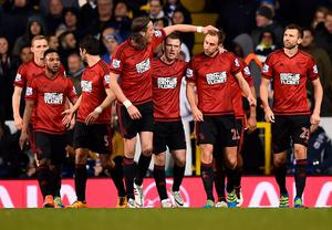 West Bromwich Albion's English defender Craig Dawson (2nd R) is congratulated after scoring his team's first goal during the English Premier League football match between Tottenham Hotspur and West Bromwich Albion at White Hart Lane in London, on April 25, 2016. / AFP PHOTO / BEN STANSALL / RESTRICTED TO EDITORIAL USE. No use with unauthorized audio, video, data, fixture lists, club/league logos or 'live' services. Online in-match use limited to 75 images, no video emulation. No use in betting, games or single club/league/player publications.  / BEN STANSALL/AFP/Getty Images