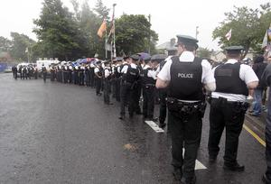 The police presence at Twaddell Avenue as Orangemen, bands and supporters march pass Ardoyne shop fronts this morning. Photo Aidan O'Reilly/Pacemaker Press