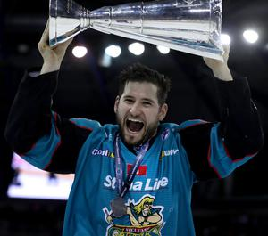 Belfast Giants forward Jordan Smotherman hoists the Elite League trophy (William Cherry/Presseye)