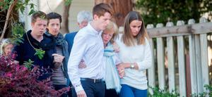 Mourners arrive at a vigil for four Irish students who died when a Berkeley apartment balcony collapsed on Friday, June 19, 2015, in Oakland Calif. The balcony at Berkeley's Library Gardens apartment complex detached early Tuesday morning killing six during a birthday party. (AP Photo/Noah Berger)