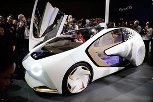 People take pictures of the Toyota Concept-i during a news conference at CES International Wednesday, Jan. 4, 2017, in Las Vegas. (AP Photo/Jae C. Hong)