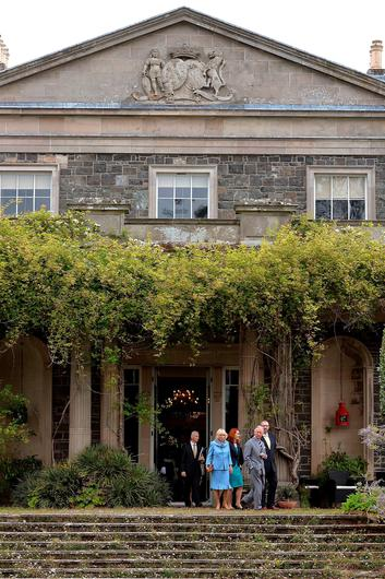 The Prince of Wales and Duchess of Cornwall emerge from the house to tour the Gardens at Mount Stewart House, in Co Down on the last day of their visit to Northern Ireland.