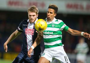 Ross County's Marcus Fraser (left) and Celtic's Scott Sinclair (right) battle for the ball during the Ladbrokes Scottish Premiership match at the Global Energy Stadium, Dingwall. PRESS ASSOCIATION Photo. Picture date: Wednesday October 26, 2016. See PA story SOCCER Ross County. Photo credit should read: Jeff Holmes/PA Wire. EDITORIAL USE ONLY