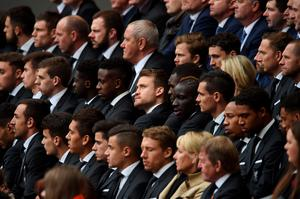 Liverpool's Belgian goalkeeper Simon Mignolet (C) sits with teammates as they attend a memorial service at Anfield in Liverpool, north west Engand on April 15, 2016, on the 27th anniversary of the Hillsborough Disaster. 96 Liverpool supporters died at the 1989 FA Cup semi-final between Liverpool and Nottingham Forest at the Hillsborough football ground in Sheffield, northern England. 2016 will be the final year a memorial service is held at Anfield. / AFP PHOTO / PAUL ELLISPAUL ELLIS/AFP/Getty Images