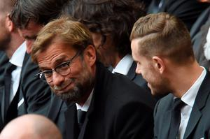 Liverpool's German manager Jurgen Klopp (L) and Liverpool's English midfielder Jordan Henderson attend a memorial service at Anfield in Liverpool, north west Engand on April 15, 2016, on the 27th anniversary of the Hillsborough Disaster. 96 Liverpool supporters died at the 1989 FA Cup semi-final between Liverpool and Nottingham Forest at the Hillsborough football ground in Sheffield, northern England. 2016 will be the final year a memorial service is held at Anfield. / AFP PHOTO / PAUL ELLISPAUL ELLIS/AFP/Getty Images