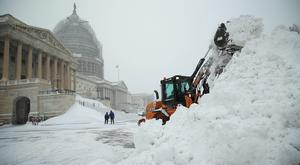 """USA: A bulldozer clears snow on the East Front of the U.S. Capitol January 23, 2016 in Washington, DC. Heavy snow continued to fall in the Mid-Atlantic region causing """"life-threatening blizzard conditions"""" and affecting millions of people.  (Photo by Alex Wong/Getty Images"""