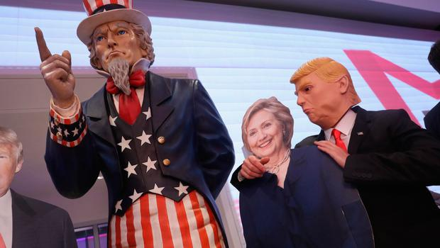 BERLIN, GERMANY - NOVEMBER 08: A guest dressed as Donald Trump (R) clowns with a cardboard effigy of Hillary Clinton at the U.S. elections party at the Bertelsmann Representation on November 8, 2016 in Berlin, Germany. Many Germans are watching the U.S. elections closely and a majority are hoping Hillary Clinton will defeat Donald Trump.  (Photo by Sean Gallup/Getty Images)