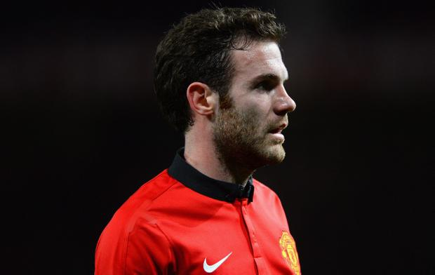 MANCHESTER, ENGLAND - JANUARY 28:  New signing Juan Mata of Manchester United looks on during the Barclays Premier League match between Manchester United and Cardiff City at Old Trafford on January 28, 2014 in Manchester, England.  (Photo by Michael Regan/Getty Images)