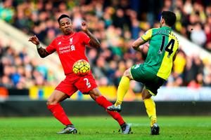 NORWICH, ENGLAND - JANUARY 23: Nathaniel Clyne of Liverpool and Wes Hoolahan of Norwich City compete for the ball during the Barclays Premier League match between Norwich City and Liverpool at Carrow Road on January 23, 2016 in Norwich, England.  (Photo by Clive Mason/Getty Images)