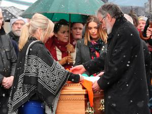 Sinn Fein President Gerry Adams and Michelle O'Neill, stand over the coffin of former deputy first minister and ex-IRA commander Martin McGuinness as it is carried to his home in Londonderry after he died aged 66. Niall Carson/PA Wire