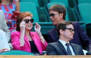 Cilla Black, Sir Cliff Richard and Colin Firth in the Royal Box on Centre Court during day eleven of the Wimbledon Championships at the 2014 All England Lawn Tennis and Croquet Club, Wimbledon. John Walton/PA Wire.