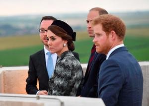 The Duke and Duchess of Cambridge and Prince Harry receiving a historical briefing on the battlefields of the Somme from the top of the Thiepval monument in France to mark the centenary of the Battle of the Somme.   PRESS ASSOCIATION Photo. Issue date: Thursday June 30, 2016. See PA story HERITAGE Somme. Photo credit should read: Tim Rooke/PA Wire