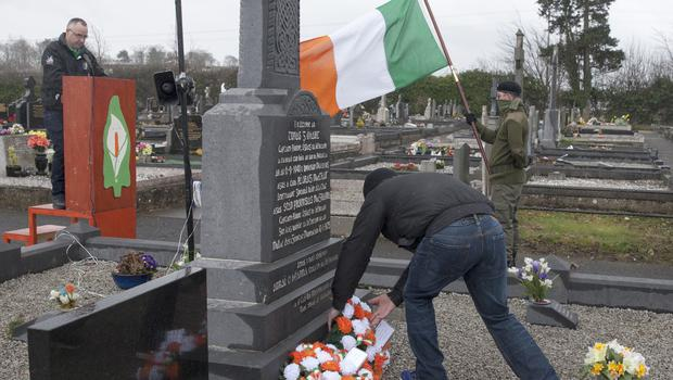 McBurney/Members of Republican Sinn Fein commemorate the centenary of the Easter Rising.  Pictured a man lays a wreath at the Republican Plot of St Colman's Cemetery  Date: Saturday 26 March 2016 Location: Kilwilkee Estate, Lurgan Credit: Liam McBurney/RAZORPIX Copyright: Liam McBurney/RAZORPIX  Liam McBurney +44 7837 685767 +44 2890 660676 liammcburney@gmail.com