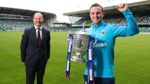Jamie Mulgrew, Linfield captain, lifts the Gibson Cup as Linfield are crowned 2019/2020 Danske Bank Premiership champions. Danske Bank's chief operating officer Liam Curran presented the trophy to Jamie at the National Stadium at Windsor Park.
