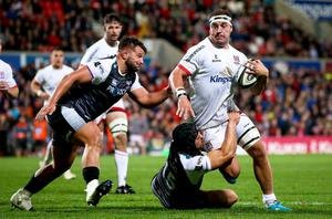 Ulster's Rob Herring with Tom Botha and Dan Evans of Ospreys (INPHO/Tommy Dickson)