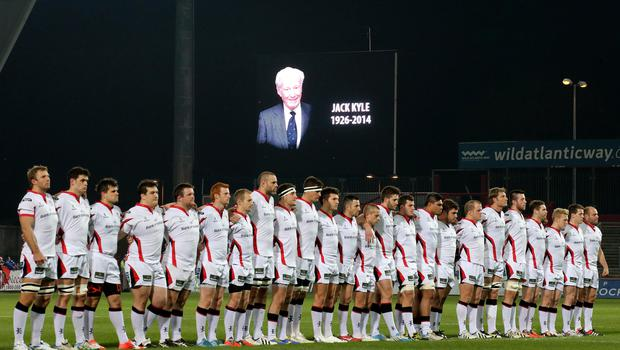 Silent tribute: Ulster players line up to remember Jack Kyle before last night's match at Thomond Park
