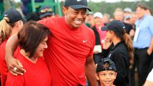 Tiger Woods celebrates with his son Charlie Axel as he comes off the 18th hole following his Masters victory.
