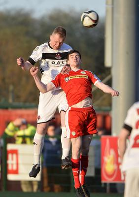 Cliftonville and Crusaders at Solitude Belfast. Cliftonville's Caoimhin  Bonner in action with Crusader's Jordan Owens. Photograph: Stephen  Hamilton /Presseye