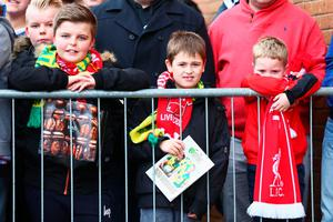 NORWICH, ENGLAND - JANUARY 23:  Young football fans wait for players' arrival prior to the Barclays Premier League match between Norwich City and Liverpool at Carrow Road on January 23, 2016 in Norwich, England.  (Photo by Clive Mason/Getty Images)