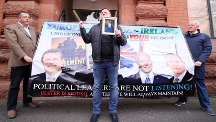The LCC protest was derailed by Gareth McCord (centre), brother of murder victim Raymond McCord jnr, who was killed by the UVF in 1997.  David Campbell, chair of the LCC (left) and former politician David McNarry, one of the founding members of the group (right), were the only attendees. (Press Eye).