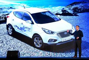 LAS VEGAS, NV - JANUARY 04:  Hyundai Motor Co. Vice Chairman Euisun Chung speaks in front of an image of a Hyundai Tucson ix35 Fuel Cell vehicle during a press event for CES 2017 at the Mandalay Bay Convention Center on January 4, 2017 in Las Vegas, Nevada. CES, the world's largest annual consumer technology trade show, runs from January 5-8 and is expected to feature 3,800 exhibitors showing off their latest products and services to more than 165,000 attendees.  (Photo by Ethan Miller/Getty Images)