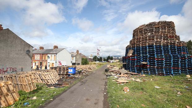 The scene in East Belfast's Chobham Street where more than 50 homes have been boarded up to protect them from a 11 July bonfire.