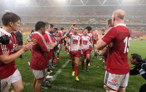 BRISBANE, AUSTRALIA - JUNE 08:  Quade Cooper, the captain of Queensland Reds leads his team off the pitch after their defeat during the match between the Queensland Reds and the British & Irish Lions at Suncorp Stadium on June 8, 2013 in Brisbane, Australia.  (Photo by David Rogers/Getty Images)