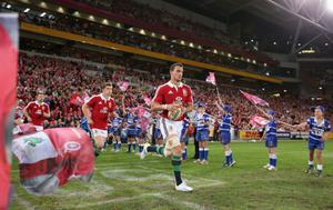 BRISBANE, AUSTRALIA - JUNE 08:  Sam Warburton, the Lions captain leads the team out onto the pitch during the match between the Queensland Reds and the British & Irish Lions at Suncorp Stadium on June 8, 2013 in Brisbane, Australia.  (Photo by David Rogers/Getty Images)