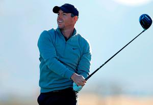 Battling back: Rory McIlroy tees off on his way to a birdie at the 13th at TPC Scottsdale