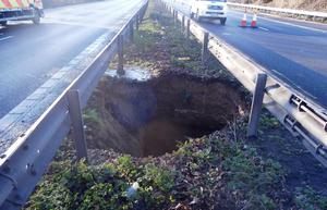 A 15ft-deep hole which appeared in the central reservation on a busy section of motorway on the M2 in north Kent and was shut between junction 5 near Sittingbourne and junction 6 south of Faversham.