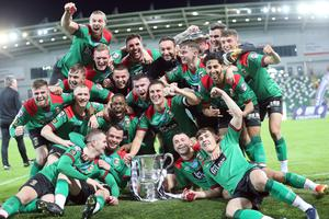 Glentoran celebrate with the Irish Cup