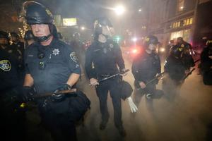 Police make a line to prevent protesters from marching Wednesday, Nov. 9, 2016, in Oakland, Calif. Police in Oakland blocked thousands of people protesting Donald Trump's election from getting onto a highway Wednesday night. The crowd chanting and waving signs gathered in Frank Ogawa Plaza in downtown Oakland in the afternoon. (AP Photo/Marcio Jose Sanchez)