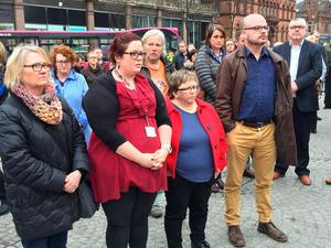 People attend a short vigil in Belfast city centre to remember murdered prison officer Adrian Ismay, whose funeral took place today. PRESS ASSOCIATION Photo. Picture date: Tuesday March 22, 2016. Mr Ismay, a married father-of-three, died eleven days after sustaining serious leg injuries in an under-vehicle bombing. See PA story ULSTER Prison Vigil. Photo credit should read: Lesley-Anne McKeown/PA Wire