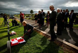 Polish MEP Anna Fotyga lays a wreath at the graves of seven Polish airmen, killed during the Second World War, at Milltown Cemetery, west Belfast. Photo: Brian Lawless/PA