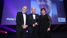 Fame game: Peter Canavan is inducted into our Hall of Fame. Presenting his award is his former Tyrone manager Mickey Harte and Breeda Toner of sponsors, Bre-Ton Financial Services
