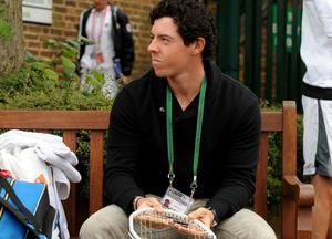 Rory McIlroy waits for his girlfriend, Caroline Wozniacki to practice during day one of the Wimbledon Championships at The All England Lawn Tennis and Croquet Club, Wimbledon. PRESS ASSOCIATION Photo. Picture date: Monday June 24, 2013. See PA story TENNIS Wimbledon. Photo credit should read: Andrew Matthews/PA Wire. RESTRICTIONS: Editorial use only. No commercial use. No video emulation. No use with any unofficial third party logos.