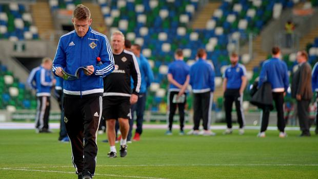 Northern Ireland captain Steve Davis reads the match day programme before Thursday evening's Euro 2016 Group F international football match at Windsor Park on October 8, 2015 in Belfast, Northern Ireland.  (Photo by Charles McQuillan/Getty Images)