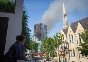 Smoke billows from a fire that has engulfed the 27-storey Grenfell Tower in west London.  Rick Findler/PA Wire