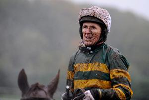 CHEPSTOW, WALES - NOVEMBER 06: A muddied Tony McCoy looks on at Chepstow racecourse on November 06, 2013 in Chepstow, Wales. (Photo by Alan Crowhurst/Getty Images)