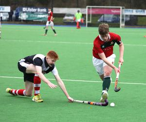 Friends School's Ollie Kidd is challenged by Wallace High School's Peter Milligan during the Burney Cup Hockey Semi-Final.  Photo by Peter Morrison