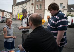 EDINBURGH, SCOTLAND - SEPTEMBER 16:  Volunteers from the Yes campaign speak with a voters in the Pilton area of Edinburgh on September 16, 2014 in Edinburgh, Scotland. Yes and No supporters are campaigning in the last two days of the referendum to decide if Scotland will become an independent country.  (Photo by Matt Cardy/Getty Images)