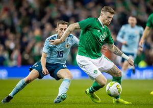 On the ball: Republic of Ireland ace James McClean takes on Northern Ireland in a 2018 friendly
